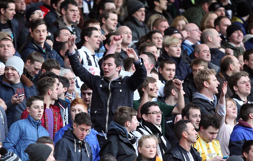 Newcastle United's Fans <br /> <br /> Photo by Kieran Galvin/CameraSport<br /> <br /> Football - Barclays Premiership - West Ham United v Newcastle United - Saturday 18th January 2014 - Boleyn Ground - London<br /> <br /> &copy; CameraSport - 43 Linden Ave. Countesthorpe. Leicester. England. LE8 5PG - Tel: +44 (0) 116 277 4147 - admin@camerasport.com - www.camerasport.com