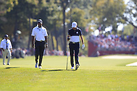 Tiger Woods (Vice-Captain Tean USA) walks down the fairway with Jordan Spieth (Team USA) during Sunday Singles matches at the Ryder Cup, Hazeltine National Golf Club, Chaska, Minnesota, USA. 02/10/2016<br /> Picture: Golffile | Fran Caffrey<br /> <br /> All photo usage must carry mandatory copyright credit (&copy; Golffile | Fran Caffrey)