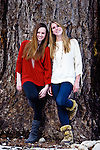 Girlfriends posing infront of big pine tree