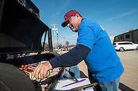 STAFF PHOTO ANTHONY REYES &bull; @NWATONYR<br /> Mike McFarland, senior vice president at Arvest Bank, seasons cooking hamburgers Wednesday, Dec. 10, 2014 at Shiloh Square in downtown Springdale. The city of Springdale, Cargill, Tyson Foods, First Security Bank, Pepsi, Arvest and United Methodist Church partnered to serve a lunch as a thank you to contractors building the Razorback Greenway through the city.