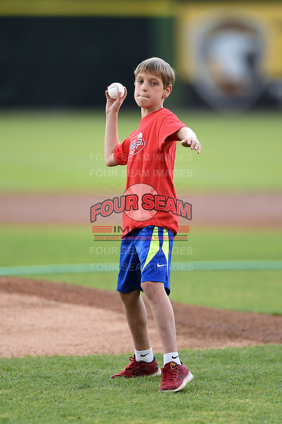 Potomac Nationals young fan throws out the ceremonial first pitch before a game against the Lynchburg Hillcats on April 26, 2014 at Pfitzner Stadium in Woodbridge, Virginia.  Potomac defeated Lynchburg 6-2.  (Mike Janes/Four Seam Images)
