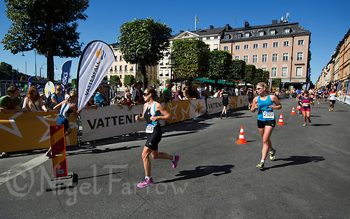 25 AUG 2013 - STOCKHOLM, SWE - Competitors runs through the streets of Gamla Stan during the Stockholm Triathlon in Stockholm, Sweden (PHOTO COPYRIGHT © 2013 NIGEL FARROW, ALL RIGHTS RESERVED)