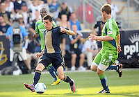 Sebastien Le Toux #9 of the Philadelphia Union crosses the ball past Jeff Parke #31 of the Seattle Sounders FC during the first MLS match at PPL stadium in Chester, PA. on June 27 2010. Union won 3-1.
