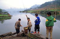 Boys fishing in lake