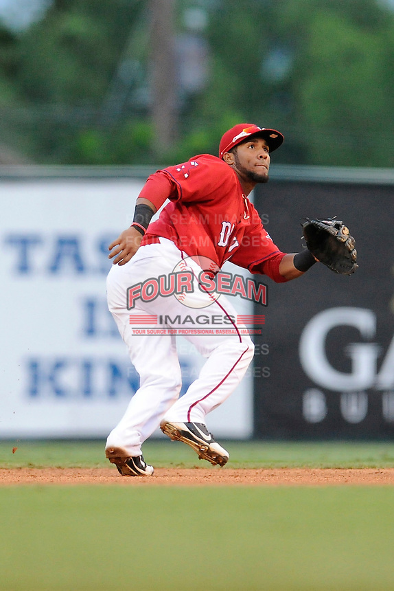 Second baseman Wendell Rijo (11) of the Greenville Drive tracks a pop fly in a game against the Rome Braves on Friday, August 1, 2014, at Fluor Field at the West End in Greenville, South Carolina. Rijo is the No. 18 prospect of the Boston Red Sox, according to Baseball America. Rome won, 5-1. (Tom Priddy/Four Seam Images)