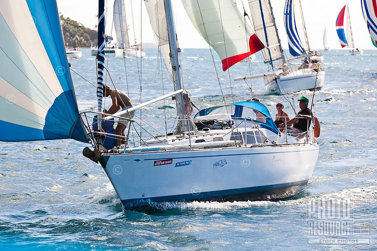 Yachts racing in the third leg of the Tahiti Pearl Regatta, racing around Tahaa Island in the lagoon