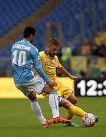 Calcio, Serie A: Lazio vs Frosinone. Roma, stadio Olimpico, 4 ottobre 2015.<br /> Frosinone's Federico Dionisi, right, is challenged by Lazio's Felipe Anderson during the Italian Serie A football match between Lazio and Frosinone at Rome's Olympic stadium, 4 October 2015.<br /> UPDATE IMAGES PRESS/Isabella Bonotto