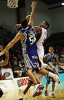 Saints guard Troy McLean tries to block Corey Webster's shot during the National Basketball League match Wellington Saints and Harbour Heat at TSB Bank Arena, Wellington, New Zealand on Saturday 13 June 2009. Photo: Dave Lintott / lintottphoto.co.nz