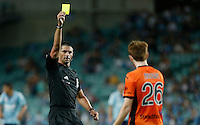 Referee Peter O'Leary shows yellow card to Brisbane Roar Corey Brown during his A-League match against Sydney FC in Sydney, March 14, 2014. Photo by Daniel Munoz/VIEWPRESS EDITORIAL USE ONLY