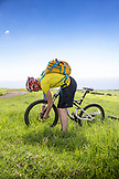 USA, Hawaii, The Big Island, mountain biker getting ready to ride pu'uhue road trail off of road 250 South of Hapuna