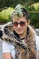 Portrait of cool woman with green mohawk, Northwest Folklife Festival 2016, Seattle Center, Washington, USA.
