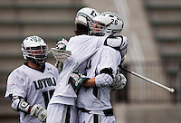 Collin Finnerty (20) of Loyola celebrates his goal with teammate (26) Stephen Murray at the Ridley Athletic Complex in Baltimore, MD.  Loyola defeated Georgetown, 11-6.