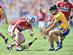 Sean O Donoghue of Cork in action against David Reidy of Clare during their Munster senior hurling final at Thurles. Photograph by John Kelly.