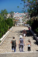 Group of people walking down path from Chan Khong pagoda, with view over Vung Tau city in background. Vung Tau, Vietnam