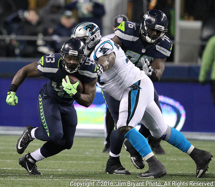 Seattle Seahawks running back Troymaine Pope (43) runs past the tackle of Carolina Panthers defensive tackle Kyle Love (77) at CenturyLink Field in Seattle, Washington on December 4, 2016.  Seahawks beat the Panthers 40-7.  ©2016. Jim Bryant photo. All Rights Reserved.