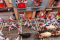 Europe,Spain,Pamplona,San Fermin festival 2018, Encierro, 8 am the bulls are released and run in the 849 m along main narrow street, while some runners fall donw