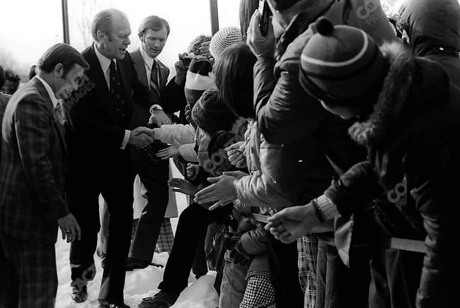 United States President Gerald Ford surrounded by well-wishers, greets crowd in Nashua, New Hampshire, February 1976.