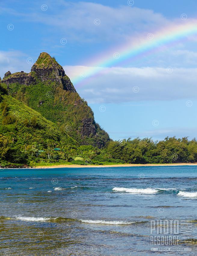 A rainbow over Makana Mountain (or Mt. Makana, also called Bali Hai), northern Kaua'i.