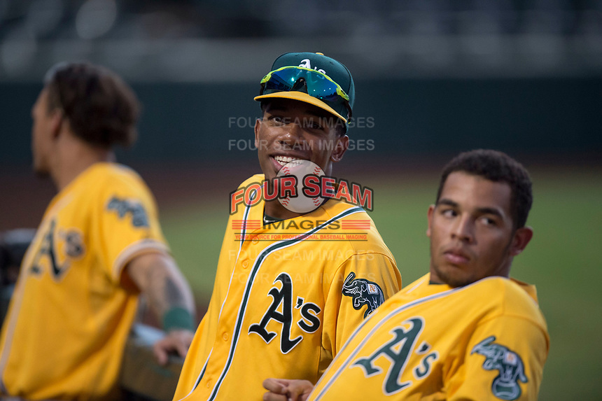George Bell (21) and Jorge Gordon (33), of the AZL Athletics, during an Arizona League game against the AZL Angels at Tempe Diablo Stadium on June 26, 2018 in Tempe, Arizona. The AZL Athletics defeated the AZL Angels 7-1. (Zachary Lucy/Four Seam Images)