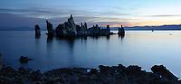 Tufa formation reflecting on Mono Lake before sunrise