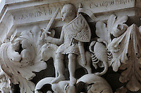 Sculpted capital of Mars (as God of War as a knight), Aries (ram) and Scorpio, carved 1340-1355, thought to be by Filippo Calendario, 1315-55, from Column 18, depicting Planets and Zodiac, of the ground floor Piazzetta San Marco columns, on the Doge's Palace or Palazzo Ducale, begun 1340 and built in Venetian Gothic style, Venice, Italy. The palace has 2 arcades with 14th and 15th century capitals and sculptures, and a loggia above with a decorative brickwork facade. It was the residence of the Doge of Venice, the supreme authority of the former Republic of Venice, until the Napoleonic occupation in 1797, and is now a museum. The city of Venice is an archipelago of 117 small islands separated by canals and linked by bridges, in the Venetian Lagoon. The historical centre of Venice is listed as a UNESCO World Heritage Site. Picture by Manuel Cohen
