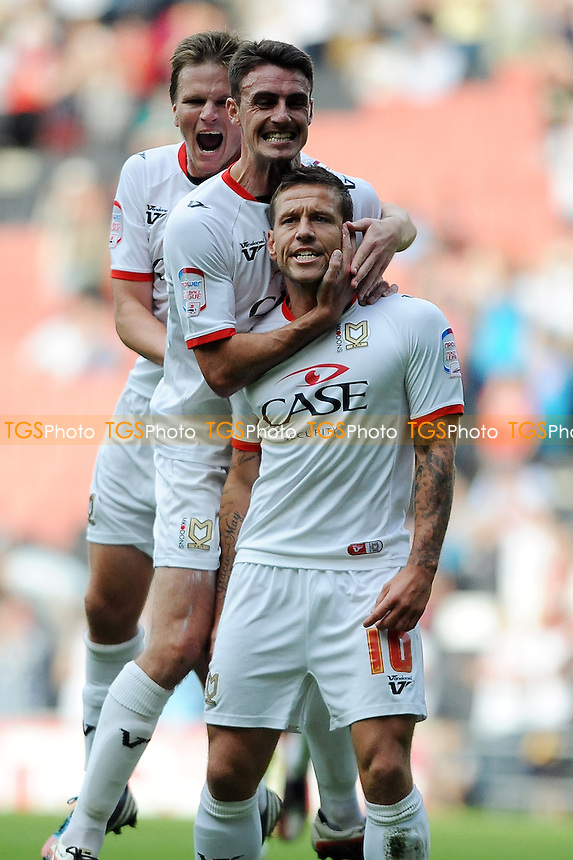 Charlie MacDonald of MK Dons scores and celebrates - MK Dons vs Yeovil Town - NPower League One Football at Stadium MK, Milton Keynes - 15/09/12 - MANDATORY CREDIT: Anne-Marie Sanderson/TGSPHOTO - Self billing applies where appropriate - 0845 094 6026 - contact@tgsphoto.co.uk - NO UNPAID USE.