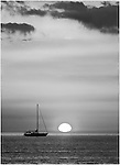 Sunset with sailboat off Lido Key, Sarasota, FL