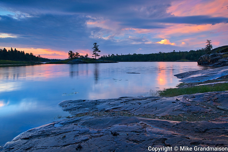 Clouds reflected in Middle Lake at sunrise<br />Kenora<br />Ontario<br />Canada