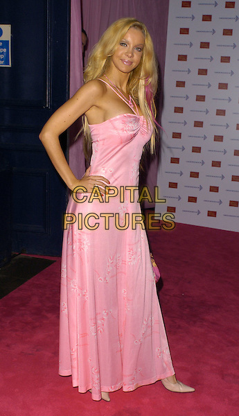 ALICIA DUVALL.Attends A Touch Of Pink Party,.madame tussards, London.England, October 5th 2006..full length pink halterneck dress hand on hip.Ref: CAN.www.capitalpictures.com.sales@capitalpictures.com.©Can Nguyen/Capital Pictures