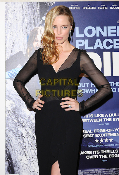 "Melissa George .""A Lonely To Die"" UK Premiere, Empire Leicester Square, London, England..7th September 2011.half length dress hands on hips sleeves black sheer.CAP/BEL.©Tom Belcher/Capital Pictures."