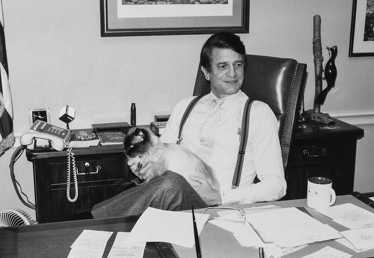 Rep. Charlie Wilson, D-Tex., with his cat at his office. (Photo by CQ Roll Call)