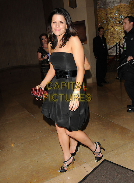 NEVE CAMPBELL.Leaving the 67th Golden Globes held at The Beverly Hilton Hotel in Beverly Hills, California, USA..January 17th, 2010 .departures full length black strapless red clutch bag belt .CAP/DVS.©Debbie VanStory/Capital Pictures