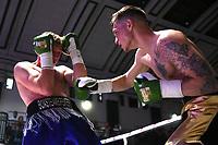 Charlie Beardon (black/gold shorts) defeats Dan Blackwell during a Boxing Show at York Hall on 10th June 2017