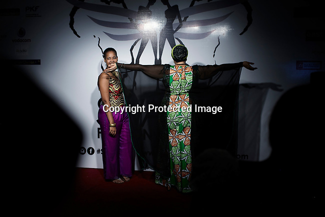 DAR ES SALAAM, TANZANIA - DECEMBER 6: Invited guests arrive before fashion shows at Swahili Fashion week on December 6, 2013 in Dar Es Salaam, Tanzania. The yearly fashion week show local Swahili designers work and invited African designers. (Photo by: Per-Anders Pettersson)