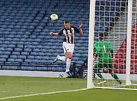 Kerr Young heads across goal in the Dunfermline Athletic v Celtic Scottish Football Association Youth Cup Final match played at Hampden Park, Glasgow on 1.5.13.