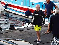 Il produttore cinematograficoe presidente del Napoli Aurelio De Laurentiis insieme al figlio Luigi asul banchina del molo Luise di Napoli subito dopo essere sbarcati dai gommoni di salvataggio con i quali si sono allontanati dallo yacht in fiamme
