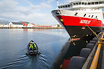 Nordlys Hurtigruten ferry ship at Svolvaer, Lofoten Islands, Nordland, Norway -adventure expedition boat setting off