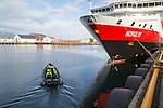 Nordlys Hurtigruten ferry ship at Svolvaer, Lofoten Islands, Nordland, Norway -adventure expedition boat setting off