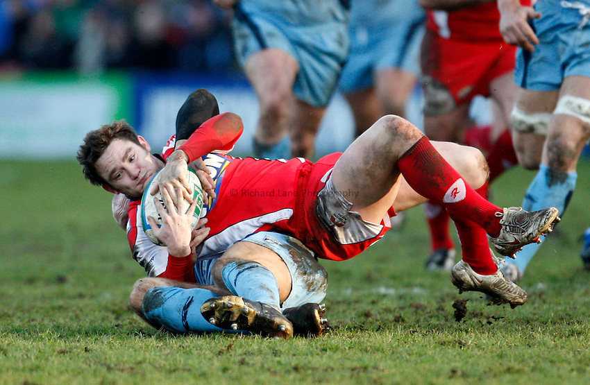 Photo: Richard Lane/Richard Lane Photography. Gloucester Rugby v Cardiff Blues. Heineken Cup. 18/01/2009. Gloucester's Ryan Lamb is tackled by Cardiff's Gareth Thomas.