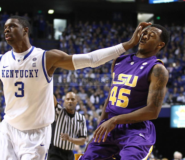 Freshman guard Terrence Jones fouls LSU player Aaron Dotson during the first half of UK's home game against LSU on Jan. 15, 2010. Photo by Brandon Goodwin | Staff.