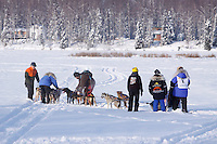 Sunday February 27, 2010   Volunteers help straigten out Jonathan Biggerstaff/Myers team on Willow Lake just after the start line of the Junior Iditarod