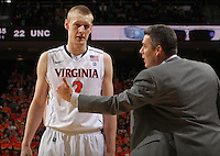 Virginia Cavaliers head coach Tony Bennett talks with Virginia Cavaliers guard Paul Jesperson (2) during the game against North Carolina in Charlottesville, Va. North Carolina defeated Virginia 54-51.