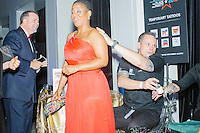 Amani Council, Executive Assistant to American Airlines' Radney Robertson, gets a GOP logo temporary airbrush tattoo at the MSNBC After Party at the United States Institute of Peace in Washington, DC. The party followed the annual White House Correspondents Association Dinner on Saturday, April 30, 2016. The party continued until about 3 AM on Sunday, May 1, 2016.