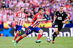 Angel Correa of Atletico de Madrid (L) runs with the ball during the La Liga match between Atletico Madrid and Eibar at Wanda Metropolitano Stadium on May 20, 2018 in Madrid, Spain. Photo by Diego Souto / Power Sport Images