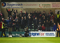 Exeter City fans celebrate the opening goal scored by Exeter City's Archie Collins<br /> <br /> Photographer Andrew Vaughan/CameraSport<br /> <br /> The EFL Sky Bet League Two - Lincoln City v Exeter City - Tuesday 26th February 2019 - Sincil Bank - Lincoln<br /> <br /> World Copyright © 2019 CameraSport. All rights reserved. 43 Linden Ave. Countesthorpe. Leicester. England. LE8 5PG - Tel: +44 (0) 116 277 4147 - admin@camerasport.com - www.camerasport.com