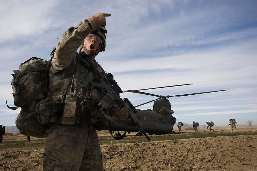 Sgt. 1st Class Jeremy Wilcox leads members of 1/506th Infantry, Baker Company, to a Chinook for extraction after a search operation in Gabikhel, Paktika Province, Afghanistan, Sunday, Feb. 15, 2009.