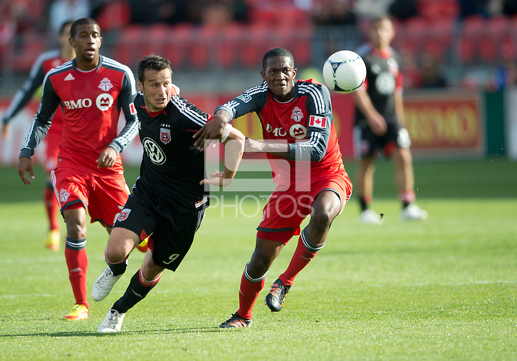 05 May 2012: D.C. United forward Hamdi Salihi #9 and Toronto FC defender Doneil Henry #4 in action during an MLS game between DC United and Toronto FC at BMO Field in Toronto..D.C. United won 2-0.