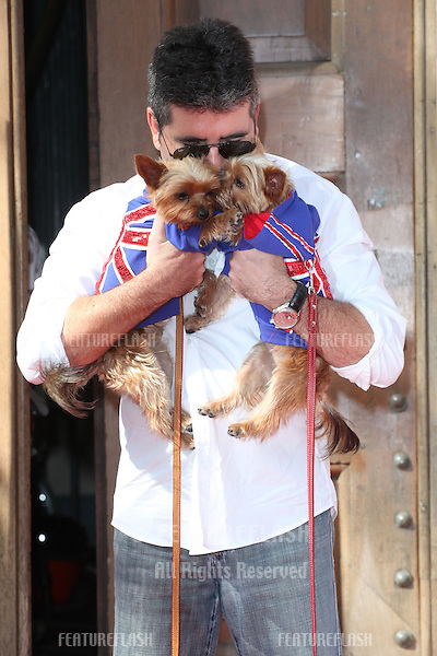 Simon Cowell and his dogs Squiddly and Diddly attending a photocall for 'Britain's Got Talent' at St Luke's Church, London. 09/04/2014 Picture by: Alexandra Glen / Featureflash