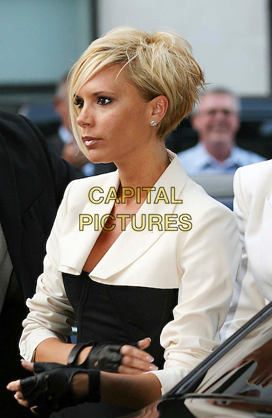 VICTORIA BECKHAM.Arrivals at the 4th Annual Glamour Women Of The Year Awards, Berkely Square Gardens, London, England. .June 5th 2007.half length black white side view fingerless gloves .CAP/JOZ.©George Jozwiak/Capital Pictures.