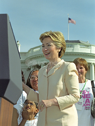 First lady Hillary Rodham Clinton prepares to make remarks as she and United States President Bill Clinton participate in the Million Mom March showing their support for stronger gun laws in the U.S. on the South Lawn of the White House in Washington, D.C. on May 14, 2000. <br /> Credit: Ron Sachs / CNP/MediaPunch